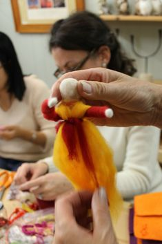 Tutorial tying sash around the wait for Magic Wool Fairy Doll