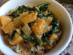 Kabocha Kale Thai Curry: Any winter squash (pumpkin, butternut, delicatta) can be substituted in this recipe.  1 cup quinoa  1 yellow onion, chopped into 1 inch pieces 3 cloves garlic, chopped 1 tablespoon coconut oil 1 very large bunch of kale (or more, whatever you like) 1 medium-sized kabocha squash 1 can full-fat coconut milk 2 tablespooons red curry paste (buy pre-made) 1 lemon cayenne pepper (optional)