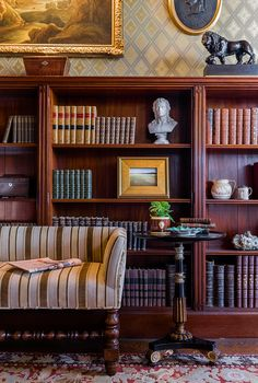 """Gentleman's Library"""" -- upholstered Jacobean bench and pedestal side table with lots of antique leather bound books."""