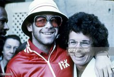 Elton John and Billie Jean King photographed at the Forest Hills Tennis Stadium in New York City, circa 1975