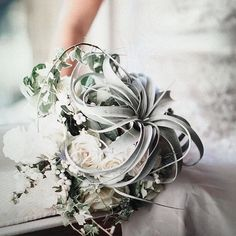 One amazing floral arrangement is coming your way! Subtle and serene we are loving this hand bouquet by @garnisheventdesign that is dominated with white and green shade. Extra loving the air plant feature that adds a glimpse of divine and modern nuance to this pretty design. What do you think about this? Show some love and tell us your thoughts!  Photography @christinaemiliephoto / Floral Design @garnisheventdesign / Gown @glitterandgritpgh / Beauty @justinelynnbrown / Model…