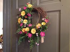Bright spring colors on grapevine wreath