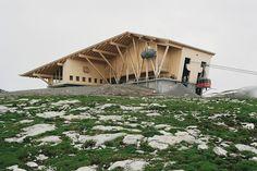 herzog & de meuron's summit building in switzerland contains a mountaintop restaurant