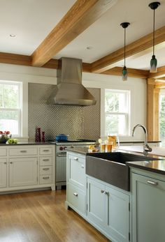 Hutker Architects - love the backsplash; soft green island w/huge black farm sink; matching oven; small drawers next to oven; natural wood beams