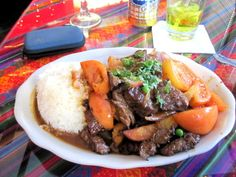 LOMO SALTADO - (Peruvian steak dish made with fresh beef sautéed with olive oil  red onions, tomatoes, and fresh herbs. Served with rice and French fries.) - Granja de Oro - Falls Church, VA