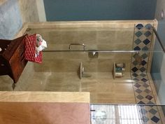 Shower made out of travertine with Sonoma tantrum glass tiles.