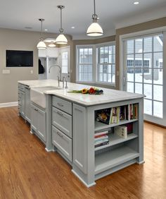 Refinished wood floors, change lighting, and update cabinet hardware for inexpensive kitchen improvements.
