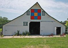 Barn quilts are large-scale quilt squares painted on plywood or directly onto the outside of barns to celebrate the tradition of quilting, the enduring majesty of rural barn structures and all the communities whose shared appreciation has turned this local art form into a national phenomenon.