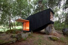 uhlik architekti balances private forest retreat on top of boulder - designboom   architecture
