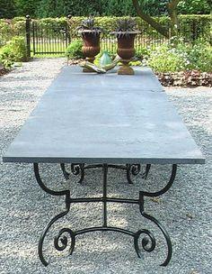 Outdoor Concrete-top Patio Table with Cast Aluminum/ Cast Iron Legs.