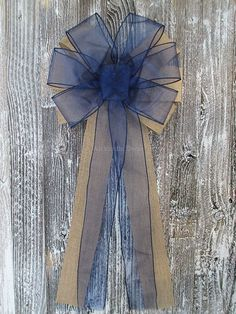 "Navy Blue Sheer Rustic Burlap Wedding Bow. Elegant for home, wedding, party decorations, bridal showers, baby showers, it's a boy decorations, church pews, aisles, and more. - Top Layer: 2.5"" wide nav"