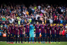 Players of FC Barcelona observe a minute of silence in memory of the victims of the earthquake in Nepal before the La Liga match between FC Barcelona and Getafe CF at Camp Nou on April 28, 2015 in Barcelona, Catalonia.