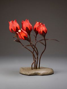 Hey, I found this really awesome Etsy listing at https://www.etsy.com/uk/listing/196029083/five-tulips-in-a-hypertufa-rock-base