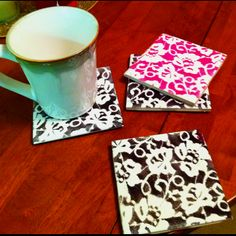 DIY coasters. Tile, lace, spray paint! (tile is 16¢ at lowes).  i'd suggest a piece/strip of felt on the bottom to prevent scratching your table.
