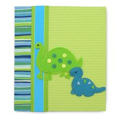 In this baby photo album design, Dino crosses a lime green brocade joined with vibrant royal blue bands. It's a handsome and fun photo album design for your baby boy.