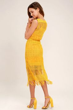The Moon River Cultivator Mustard Yellow Lace Midi Dress has really grown on us! A vibrant crocheted lace overlay shapes a bateau neckline and sleeveless bodice. Body-skimming, midi silhouette with fringe-y hem.