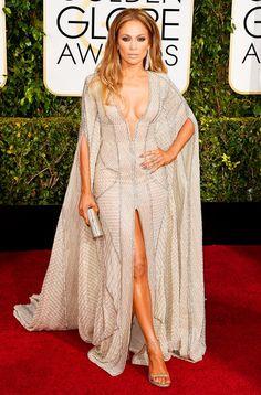 Jennifer Lopez in a Zuhair Murad silver art deco inspired beaded sheer caftan, Lorraine Schwartz jewelry, Jimmy Choo clutch and Stuart Weitzman heels at the 72nd Annual Golden Globes