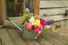 Wedding décor- watering can of British flowers.