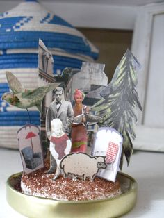 Handmade christmas nativity scene from cut up old books - inside a snow globe