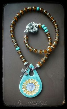 """Im loving the colors in this necklace, they are just begging for sunshine and a beach! Porcelain pendant by Round Rabbit, pewter flower and bee clasp by Green Girl, honey gold czeck glass and a sweet arte metal dragonfly charm. This necklace measures 19"""""""
