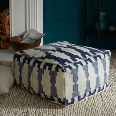 Pretty blue and white ottoman.    CHIC COASTAL LIVING: 10 BEST:: Winter Beach House Accessories
