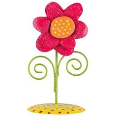"Help your decorations bloom into something beautiful with Pink Single Flower on Yellow Stand. This adorable metal flower features a polka dot stand and a single, layered flower stem with green curls. In pink, this flower is perfect for mantels, counters, tables, desks, bookshelves, and more!    	     	Dimensions:    	  		Flower Width: 4""  	  		Height: 7 1/4""  	  		Base Diameter: 3 3/4"""