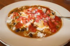I tried Qdoba's mexican gumbo and had to find a recipe. Mexican gumbo starts with lime cilantro rice then you top it with beans. Next you pour the lovely soup on top and if you want meat just sprinkle on top with cheese and salsa. This can very easily be made vegetarian. This recipe looks very good! I will be trying this very very soon!