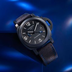 A true highlight of this Panerai Luminor GMT Bucherer BLUE special edition is the exclusive Bucherer BLUE touch included in various subtle details of the timepiece: 44 mm, ceramic case, black arab./indices, Automatic Calibre P.9010/GMT, sapphire glass 30 Atm. Interchangeable straps: black textile watch strap with blue stitching and additional black coutchouk. Only available at Bucherer. Panerai Luminor Gmt, Time Management, Highlight, Stitching, Sapphire, Product Launch, Touch, Watches, Glass