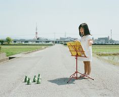 Japanese photographer Toyokazu Nagano, taking just the most adorable photos of his youngest daughter, Kanna. Each picture is taken on the same road, with little Kanna giving all of her into each pose and mood.