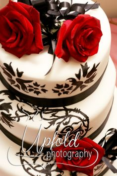We loved this elegant Red-White and Black wedding cake. The look was dramatically elegant, with the stenciled black detail giving it a somewhat vintage look too. Image by Upfold Photography. ~ Elegant Wedding cake ~ Red Black and White wedding cake ~ stencil work on wedding cake ~