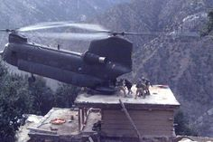 US Army Boeing CH-47 Chinook making rooftop pick up in Afghanistan.