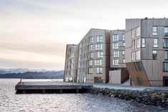 AART architects aligns timber waterfront residences with the norwegian coastline