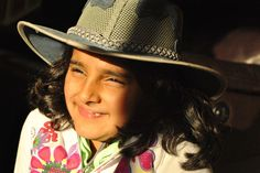 Cow Girl: This is a picture of my daughter, enjoying the sun in her favorite cowgirl hat.