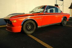 This 1975 BMW 3.0CSi (chassis 2267904) has been built into a CSL clone with side stripes, front splitters, fender trim, roof hoop, and chin spoiler. We love orange on these cars ever since running with a spectacular genuine Inka CSL on the Northwest Classic Rally two years ago (scroll for pic). This