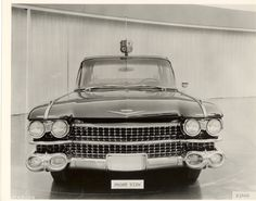 1959 Cadillac Landau Limousine.  Royal shield mounted on the leading edge of the roof, centered above the windshield