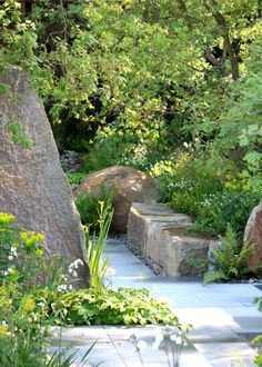 Chelsea 2016 - The M&G garden. Flag irises emerge from the base of a sandstone monolith | thefrustratedgardener
