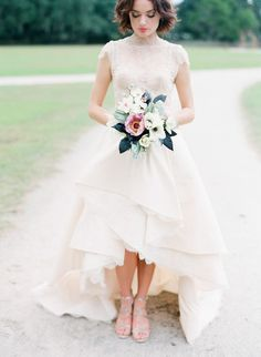 Beautiful lace wedding dress with a high/low skirt. Perfectly lovely!