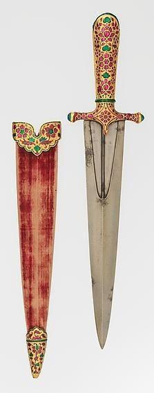 SUA / New York / The Metropolitan Museum of Art Pumnal mughal (mogul) din perioada domniei lui Jahangir (1605-1627); oţel, aur, lemn, material textil, rubine, smaralde şi sticlă. Lungime 37,1 cm.