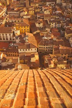 Climb to the top of Duomo of Florence for roof top shots of the city below
