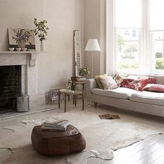 Cowhide Rug. Like the leather seat pillow as well.