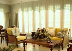 I love this sun room.  Casual but elegant. I love how we let the light shine through soft valances.