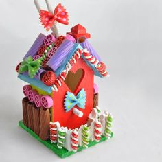 Transform a wood birdhouse into a crafty gingerbread house treasure with painted pasta. Great kids craft idea!
