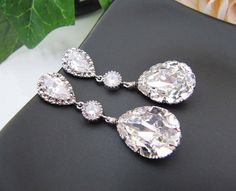 Wedding Bridal Jewelry Bridal Earrings Bridesmaid Earrings Clear White Swarovski Crystal and Cubic Zirconia Tear drops. $36.80, via Etsy.