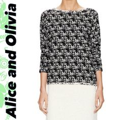 "Alice and Olivia  lovely sweater Alice and Olivia B&W knit🍭it says Boxy but it's not! There isn't any stretch to this. It's a nice flattering shape that you would expect with raglan sleeves.   ✍🏽crewneck ✍🏽raglan sleeves ✍🏽stops approx at top of hip ✍🏽graphic Intarsia throughout ✍🏽neck and hemline contrasting ✍🏽64%acrylic35%polyester1%spandex  Size Medium... A small to mid medium. Could work on a small. If you are larger than 36D you might find it more snug.  20"" armpit to armpit…"