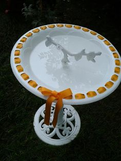 spray painted bird bath white, then thread ribbon for holidays..or whatever I have hanging around