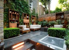 Marvelous Designs Outdoor Living Spaces. Great mix of planting with built in furniture and timber detailing. Great use of space.