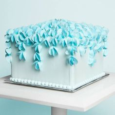 """You can now learn The Wilton Method®: Piping Flowers anytime, anywhere! A timeless addition to cakes and treats, piped flowers are a wonderful choice for special occasions or """"just because."""" In this online class, you'll make and use royal icing to pipe a collection of classic flowers."""