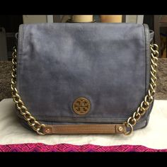 "Tory Burch Slate Leather Shoulder Bag VERY RARE! Tory Burch Blue-Gray Slate Leather Shoulder Bag with Gold Tone Chain & Leather Strap. Emblem at front flap, one interior zip pocket and two interior slip pockets, detachable interior cosmetic mirror, front snap closure. Measurements: 10"" H x  13"" W x 4"" D- 7"" Shoulder Strap Drop. In Excellent Preowned Condition. RETAIL $575.00 Tory Burch Bags Shoulder Bags"