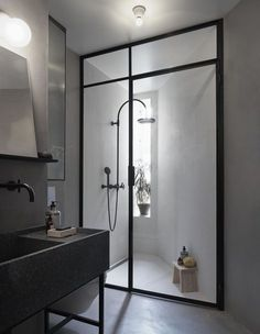 The dark fixtures used in this room help to create a sophisticated and modern bathroom design.