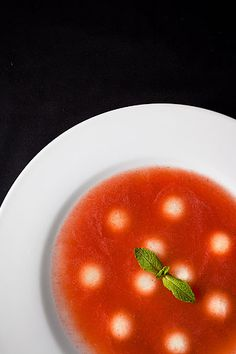 Tomato-watermelon soup with a sprig of mint.
